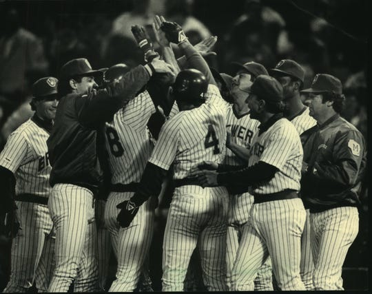 Paul Molitor (4) joined teammates in congratulating Rick Manning after Manning's hit gave the Milwaukee Brewers a 1-0 victory over the Cleveland Indians.