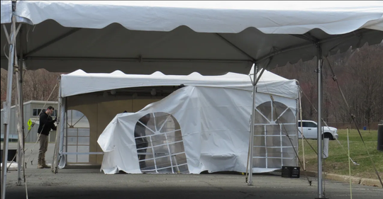A Party Pleasing Rental company prepares tents at College County of Morris where a coronavirus testing center is set to open.