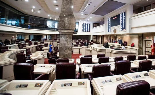 Alabama Speaker of the House Mac McCutcheon gavels out after a quorum call in the nearly empty house chamber at the Alabama Statehouse in Montgomery, Ala., on Thursday March 26, 2020.