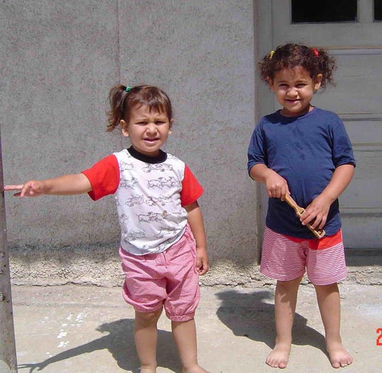 Sarah (left) and Alex Caver (right) as children.
