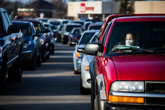 More than 400 cars, many with multiple occupants, were parked outside of the closed Muncie Mall for a Second Harvest Tailgate that gave away food to families in need early Thursday. The tailgate is one of several Second Harvest is holding to combat hunger during the coronavirus pandemic.