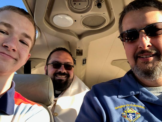 Pilot Daniel Schachle, and his son, Joseph Schachle, fly with the Rev. Gervan Menezes, a priest in the Roman Catholic Diocese of Nashville, to pray for Tennesseans.