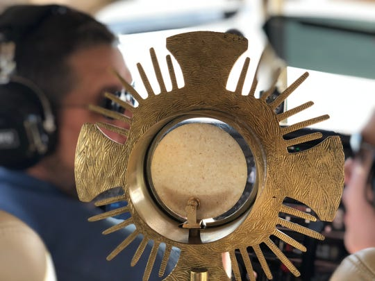 The Rev. Gervan Menezes, a priest in the Roman Catholic Diocese of Nashville, brought a consecrated host on a flight Thursday around Middle Tennessee.