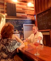 House of Brews owner Dan Smith talks with patrons.