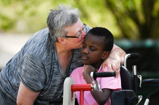 Tori Wentz kisses her son Ricky, 11, outside their West Knoxville home Thursday, March 26, 2020.