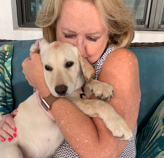 Cindy Beherns, with Ella Mae, her new rescue pup