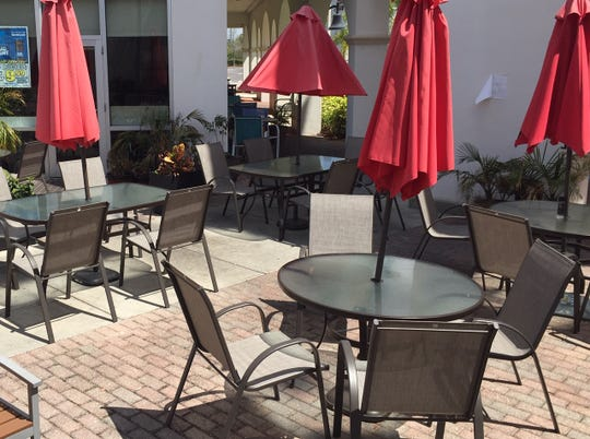 Empty tables at The Eatery By Ryan in San Carlos Park on Thursday, March 26, 2020. Florida Gov. Ron DeSantis has banned all on-site dining during the coronavirus outbreak.
