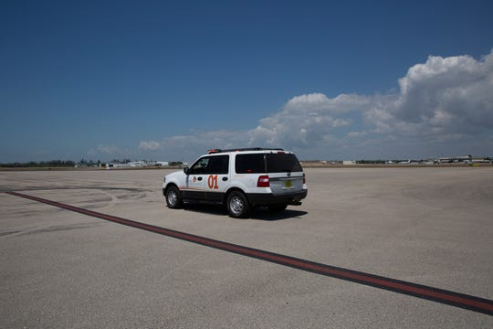 Mike Hushek, the fixed-base operator manager at the Naples Airport, parks his patrol vehicle in the empty overflow parking terminal, Thursday, March 26, 2020, at the Naples Airport.