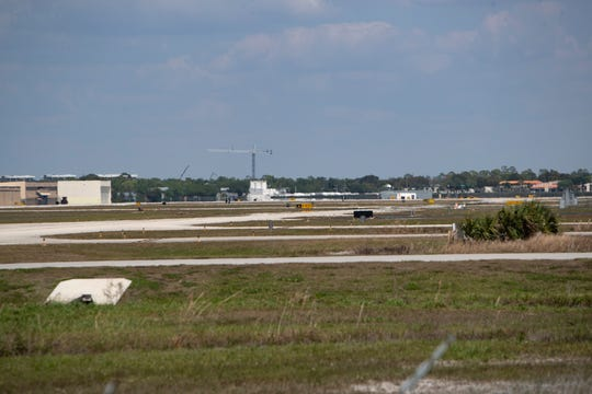 The empty runway at the Naples Airport is pictured on Thursday, March 26, 2020.