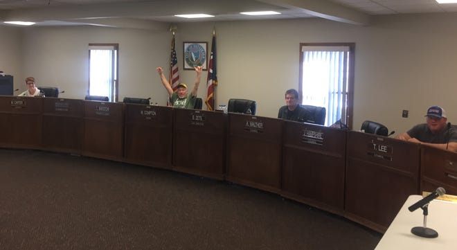 Pataskala city officials (from left) Melissa Carter, Mayor Mike Compton, Andy Walther and Tom Lee practice social distancing at Wednesday city administrator search committee meeting.