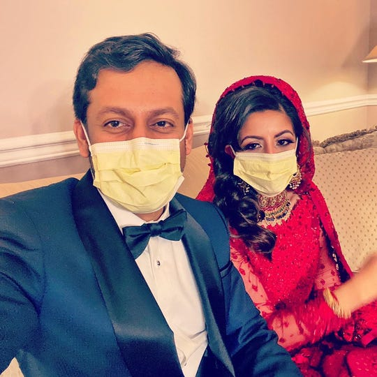 Kashif Chaudhry and Naila Shereen celebrate their marriage at her parents' home in New Windsor, NY. Amid a coronavirus outbreak, the doctors canceled a large wedding and honeymoon and went back to work.