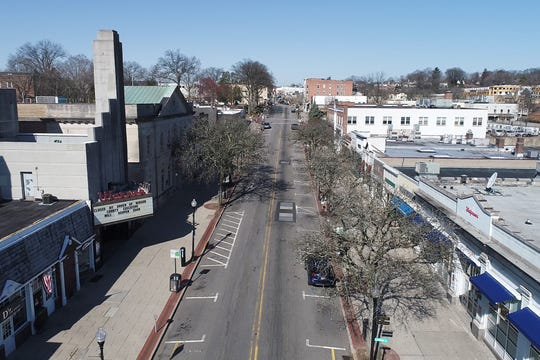 East Ridgewood Ave is deserted in downtown Ridgewood, N.J. on Thursday March 26, 2020. Residents in New Jersey have been asked to stay at home during the coronavirus pandemic.