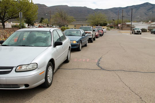 A line of cars waits to be served during the Alamogordo Senior Center's curbside meal service March 26.