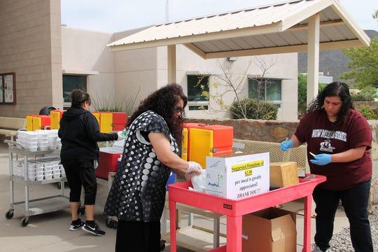 Alamogordo Senior Center staff prepare meals for curbside meal service March 26.