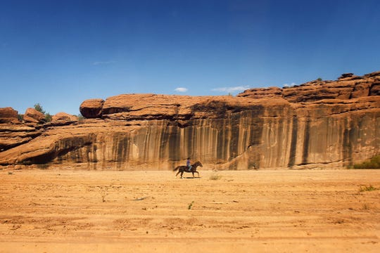 A boy rides his horse on Oct. 19, 2014, at Canyon de Chelly National Monument in Chinle, Arizona.