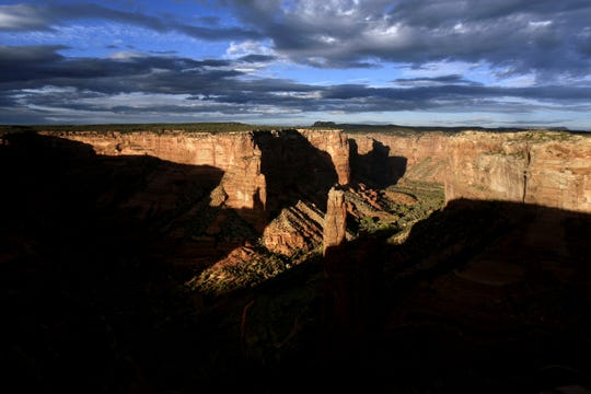 The sun sets on Spider Rock in October 2014 at Canyon de Chelly National Monument in Chinle, Arizona.