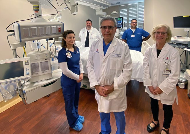 Eisenhower Health clinical staff are photographed on March 25, 2020, in a critical care room with lifesaving equipment, including a ventilator, vital to the care of patients with COVID-19. Front row, from left: ICU nurse Sonia Rios, BSN, RN; Shahriyar Tavakoli, MD, medical director, critical care; Tina Wallum, MSN, RN, director, critical care units/dialysis. Back row: Sedrick Bedolla, director, respiratory care, pulmonary services and neurology, and Anil Perumbeti, MD, board certified in critical care medicine and pulmonary disease.