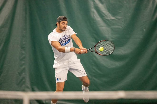 UWF senior tennis standout Serdar Bojadjiev hits a shot in an undated photo. Bojadjiev is one of several international student-athletes at UWF who is sheltering in the United States amid the COVID-19 pandemic.