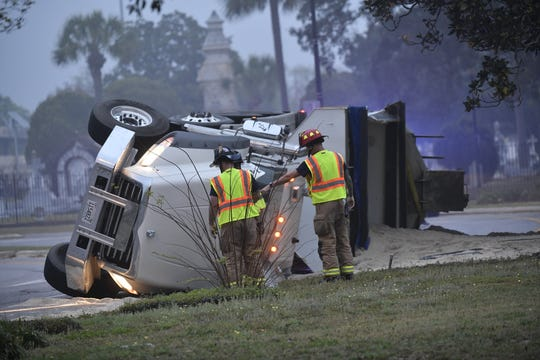 A dump truck flipped over and off of the offramp fromI-110 to Garden Street Thursday morning, causing traffic delays.