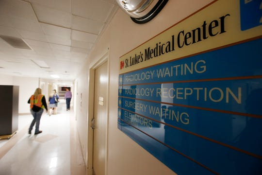 A group from the U.S. Army Corps of Engineers and the Arizona health department tour the currently closed St. Luke's Medical Center hospital to see the viability of reopening the facility for possible future use due to the coronavirus Wednesday, March 25, 2020, in Phoenix