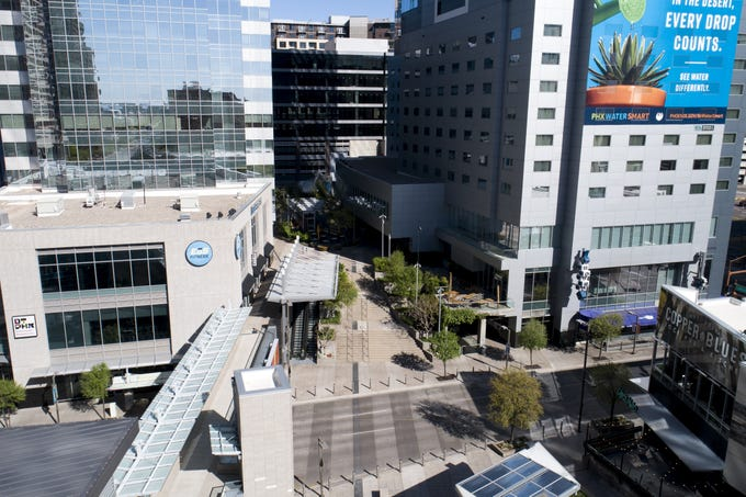 As many Phoenicians work from home due to the COVID-19 pandemic, Cityscape appears empty and void of traffic in downtown Phoenix on March 24, 2020.