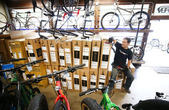 Mar. 25, 2020; Phoenix, AZ, USA; Mike Stransky, a salesman at Grey Matter Family Bike Shop received a new shipment of bicycles due to higher demand as the people stay home during the coronavirus health crisis on Mar. 25, 2020 in Phoenix, Ariz. Mandatory Credit: Rob Schumacher, The Arizona Republic