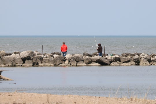 People fishing near Waterworks Park in Port Clinton on Thursday. Outdoor activities are permitted under the stay-at-home order in place for Ohioans amid the coronavirus pandemic.