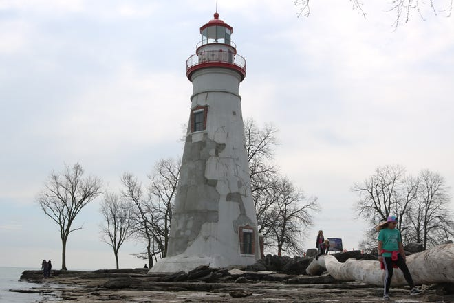 A few local families took advantage of the warm spring weather at the Marblehead Lighthouse on Thursday, enjoying outdoor activities, which are permitted under the stay-at-home order in place for Ohioans amid the coronavirus pandemic.