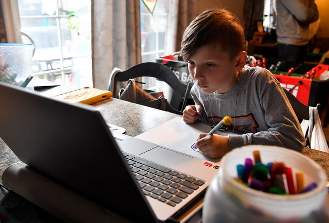 Nolan Matseur, 6, draws from an online instructional video as the Mount Wolf family have had to juggle homeschooling during the pandemic shutdown. Wednesday, March 25, 2020. John A. Pavoncello photo