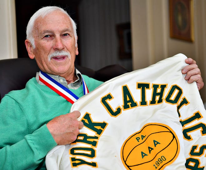 Former York Catholic boys' basketball coach Mike Keesey is shown with his 1990 AAA state championship jacket at his home in West Manchester Township, Thursday, March 26, 2020. Keesey shaved his head during a fundraiser to purchase the jackets for the team. Dawn J. Sagert photo