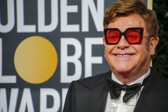 """Elton John will host """"The iHeart Living Room Concert for America"""" on Sunday."""