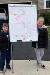 Patrick, 5, and Olivia, 10, Coyne stand with their sign before Tuesday's parade of teachers in northern York County. These parades, going on elsewhere in the county and the country, are a way for teachers to connect with their students as they stay home during the coronavirus pandemic.