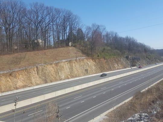 Exposure of schist just south of the Loganville interchange on the east side of highway.
