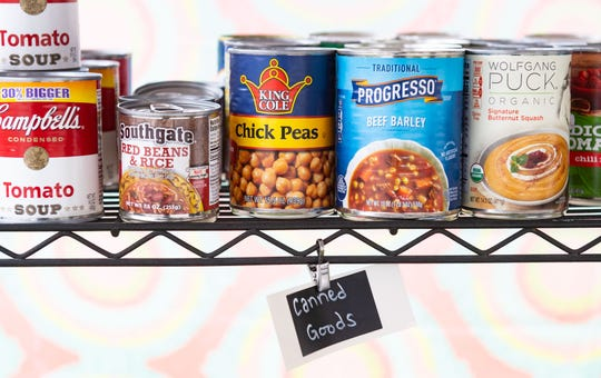 A variety of canned goods sit in the food pantry in Dover.