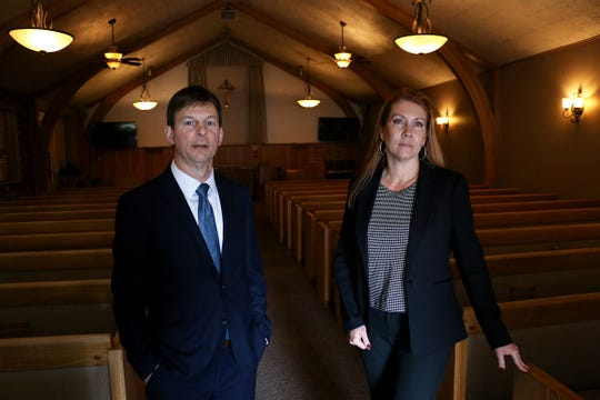 Owners Rick Noel and Kim Kandaras pose for a portrait in Walton's Sierra Chapel on W. Second St. in Reno on March 26, 2020.