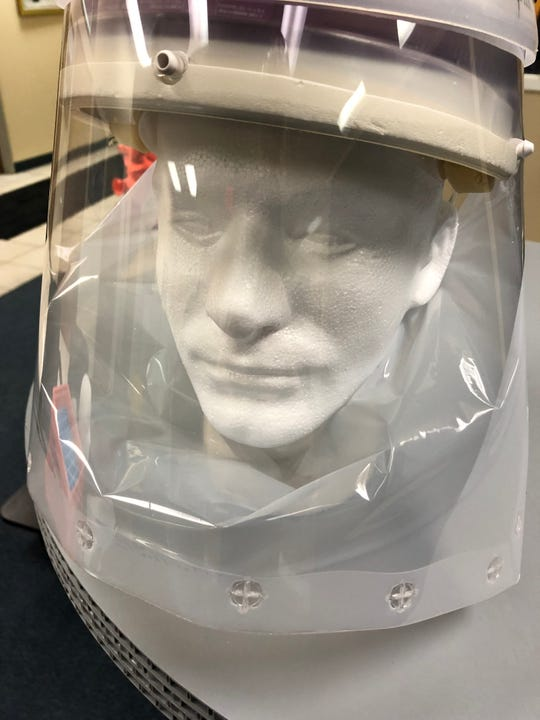 Primex Plastics developed a face shield that fits firmly around the neck to protect Reid Health employees from the novel coronavirus COVID-19.