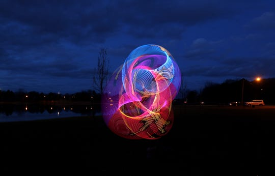 Taylor Cauwels of Rochester, found an open space in Cobbs Hill Park to use her light up smart hoop ( a hulahoop with lights).  A long shutter speed created the light trails in the photo. Cauwels said she was aware of her distancing from other and that her smart hoop was one of her favorite things.