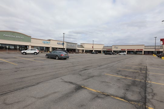 Many businesses had to either shut their doors to stop the spread of Covid-19 or for restaurants turn into take out only, a few businesses are open in Jay Scutti North plaza in Henrietta  on March 25, 2020.