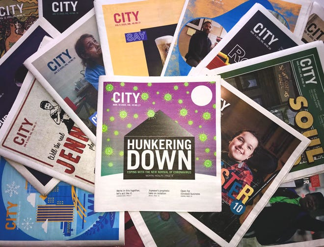 A selection of CITY newspapers, with its last print edition before print shutdown at center.