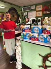 Shreveport tattoo artist Micah Harold shows off a few of the supplies he is collecting to help those in need during the COVID-19 pandemic.