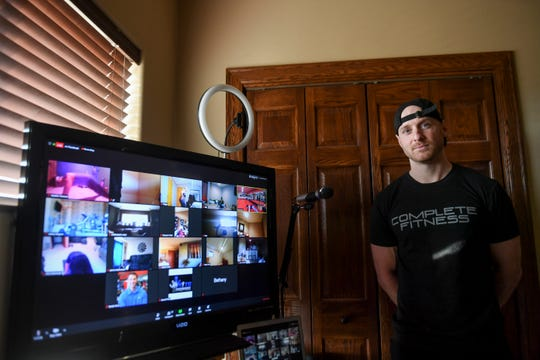 James Tjeerdsma leads a fitness class from his home on Thursday, March 26, 2020 in Sioux Falls, S.D. Tjeerdsma says they are taking this time to focus on overall wellness.