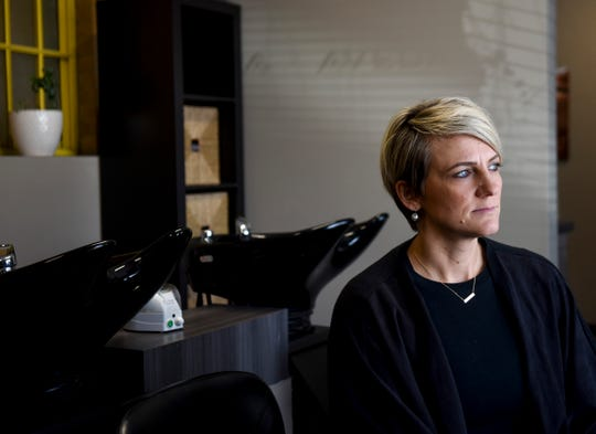 Gloria Kolbeck, owner of Vanessen's Hair Design salons poses for a portrait on Thursday, March 26, 2020 in Sioux Falls. Kolbeck has begun screening people coming into the salon and has implemented changes to adhere to the CDC guidelines on the coronavirus.