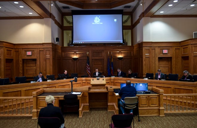 City Council votes to pass an ordinance limiting businesses due to the coronavirus on Thursday, March 26, 2020 in Sioux Falls, S.D.