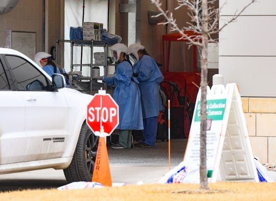 People drive into a garage to be tested for COVID-19 on Thursday, March 26, at the Avera Medical Group Family Health Center in Sioux Falls.