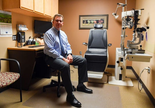 Ophthalmologist Bryan Hammer sits in an exam room on Thursday, March 26, at Ophthalmology Ltd. in Sioux Falls. The practice is closed to all patients with non-urgent or emergent cases due to coronavirus concerns.