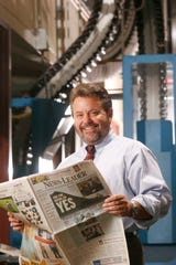 Tom Tate, production director of the Springfield News-Leader, oversaw the 2002 installation of the paper's $23 million printing press. The press will make its final run Sunday night.