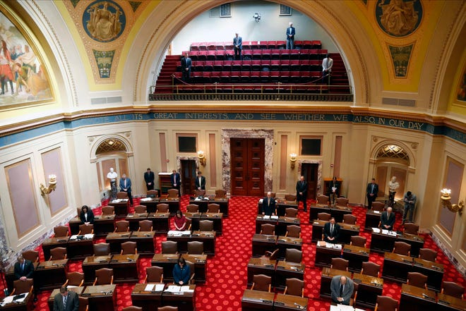 State senators keep a social distance on the Senate chamber floor in this file photo from March 26, 2020, at the Capitol in St. Paul.