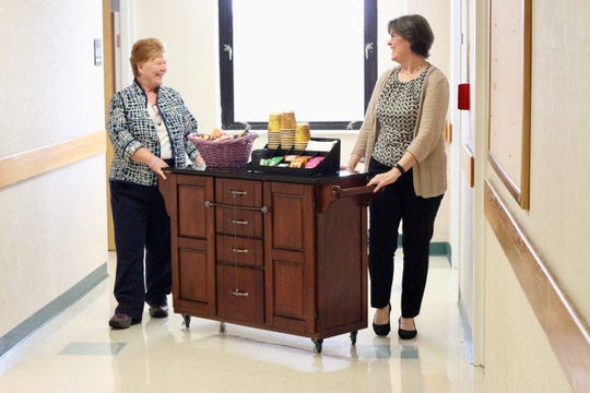Jenny Lannom, Director of Spiritual Care at Tallahassee Memorial HealthCare, and Leigh Vander Meer, Chaplain,  with Code Lavender cart for staff and caregivers.