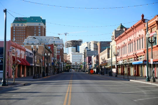 El Paso street in downtown El Paso is nearly vacant Wednesday, March 25, in El Paso. El Paso officials issued a 'Stay Home, Work Safe' order Tuesday to help halt the spread of coronavirus.