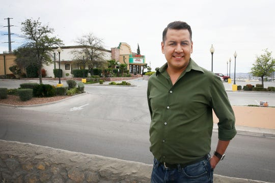 Adrian Loera, bartender at Landry's Seafood House, in background, for 19 years, was temporarily laid off March 20 due to the city's coronavirus-related business restrictions, including ordering bars closed.